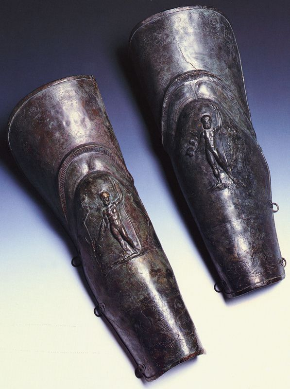 *POMPEII, ITALY ~ Greaves. Pair of bronze gladiator's greaves (leg guards) from Pompeii decorated with relief of Jupiter (left) and Neptune (right).