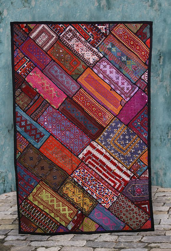 Fabulous Fair Trade, Handmade Vintage Kuchi Wall Hangings. Each is absolutely unique, but all are made from Bright Earth Tone, Cotton Vintage Patches. Approx. 42 x 64 inches. Backing of cotton fabric and even the import tags are handmade. Tabs for hanging.