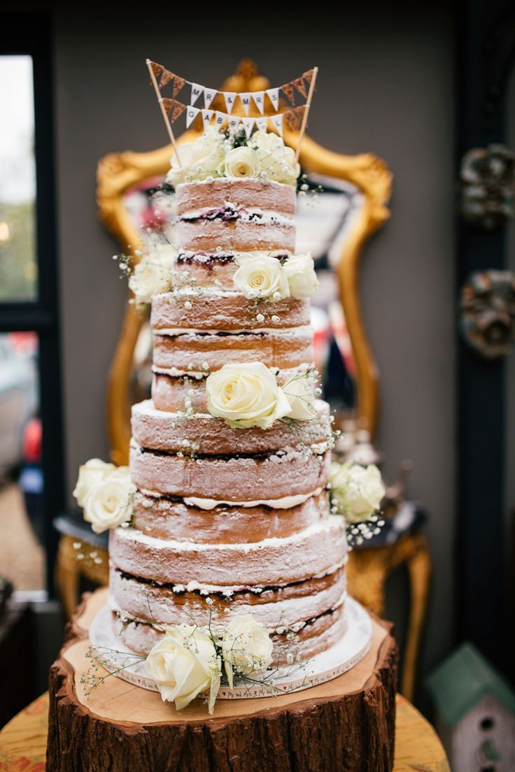 Four tier naked Victoria sponge cake decorated with fresh flowers | Photography by http://www.joannanicolephotography.com/