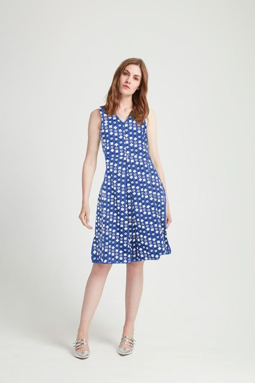 Embrace high summer chic in this precious organic cotton dress. This midi style is crafted from structured panels that flatter and slim your frame. It's perfect for warm-weather events - style yours with flats and a straw bag for the day and heels with a metallic clutch for an evening event.   The model is wearing a UK size 10