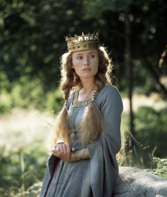 I love the gathering of the gold-tan chemise under the embroidered neckline of the beautiful watchlet coloured dress. I also like her hair twists and banding. Victoria Smurfit as Queen Rowena in Ivanhoe.
