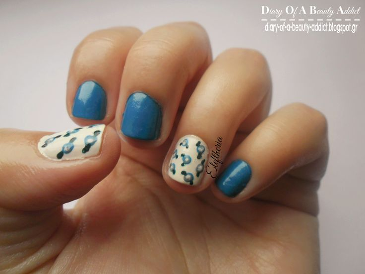 Simply Nails ▎❝Blue with Roses❞  read more:http://diary-of-a-beauty-addict.blogspot.gr/2014/03/simply-nails-blue-with-roses.html