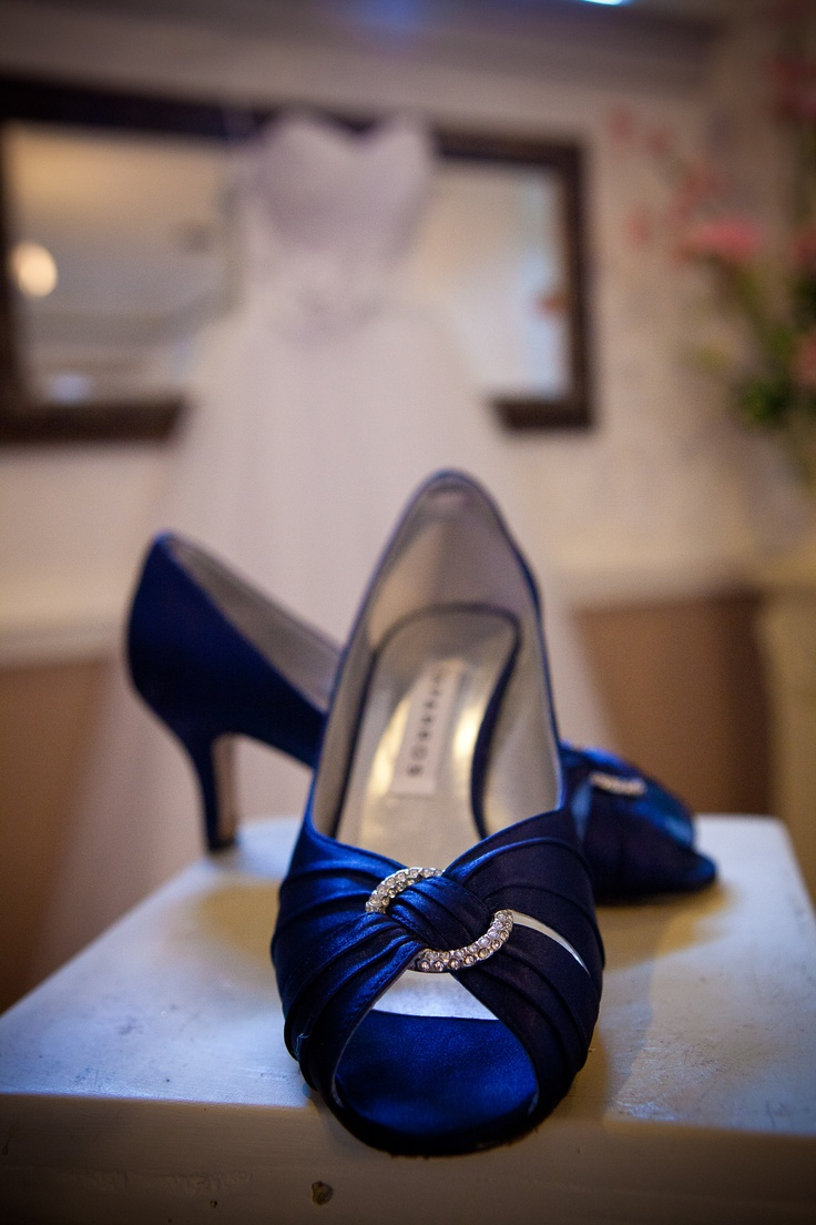 Love this shot with the wedding dress in the background for Blue shoes for wedding dress