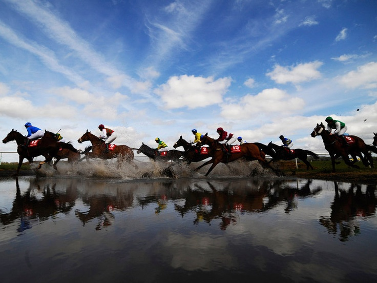 Runners take Joe's Water Splash at the start of the Punchestown festival in Ireland.