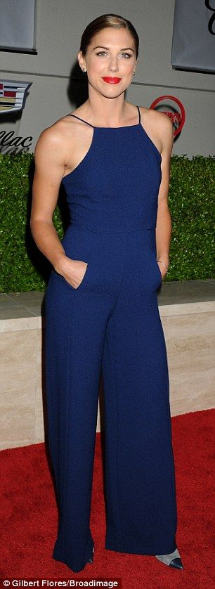 Cool blue: Another American soccer star at the bash was Alex Morgan, who stunned in a navy...