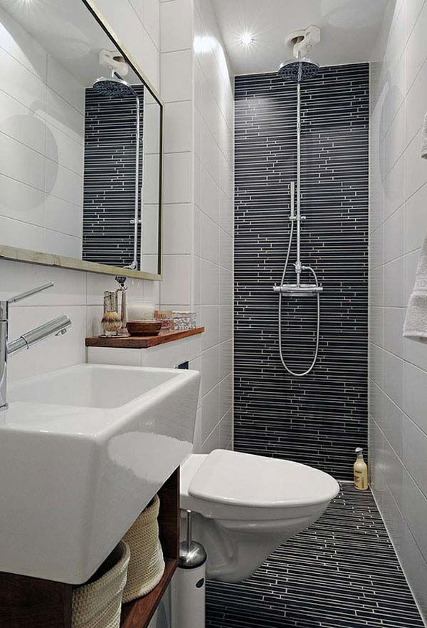 feature tiling the back wall of the bathroom makes the whole thing look - Design Small Bathrooms