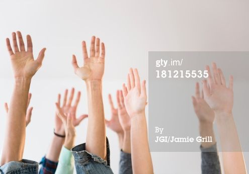 Stock Photo : People's hands raised in air