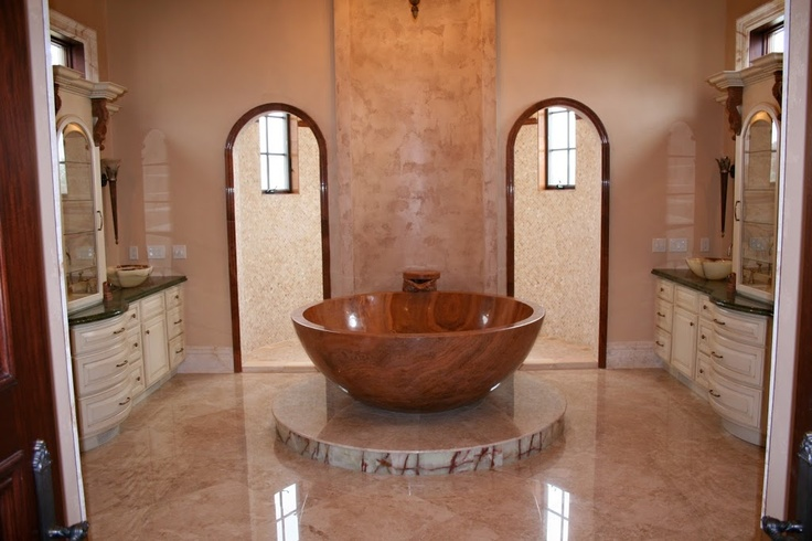 This stunning master bathroom features a hand carved for Bathroom 00