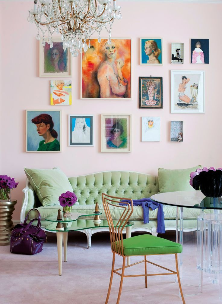A lovely gallery wall with art that is unified by modern style, (mostly) simple frames, neutral colors and a horizontal center line (plus links to some other gallery walls and holly becker's book on decorating.) #rowenamurillo