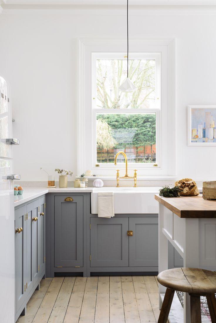 Grey and white open shelf kitchen.