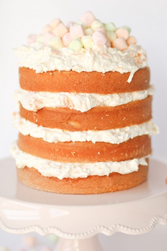 This light, fruity, coconutty Ambrosia layer cake is perfect for Spring!! White cake layers are filled with a lightly sweet whipped filling full of citrus and coconut.
