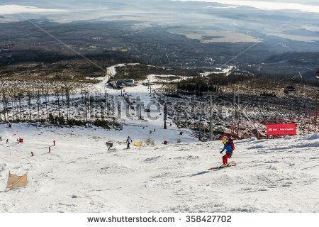 Tatranska Lomnica, Slovakia - December 26, 2015: Skier with a backpack and a helmet on the slopes.  - stock photo