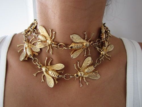Bee necklace...I think I could make something like this with gold spray paint! I saw a tutorial for making a gold snake belt that way, could be great for Halloween (beehive hair, etc.).