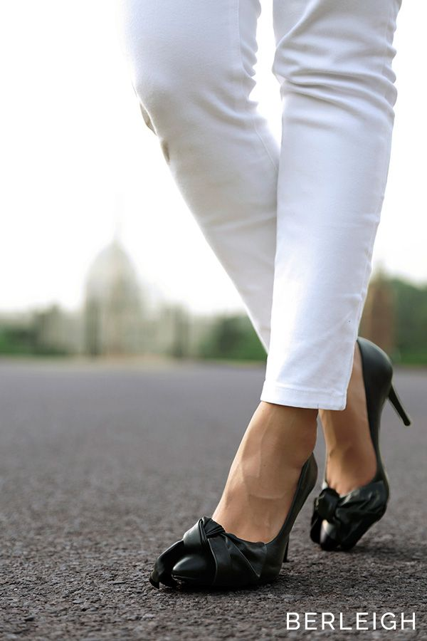 8cb5f4b1d83 Schutz black bow pumps  An oversized bow stunningly drapes around the charm  of this classically