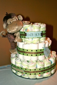 monkey baby shower decorations  diaper cake ! all you need is diapers, rubber bands, ribbon and you can add whatever else you would like! like baby stuff :)