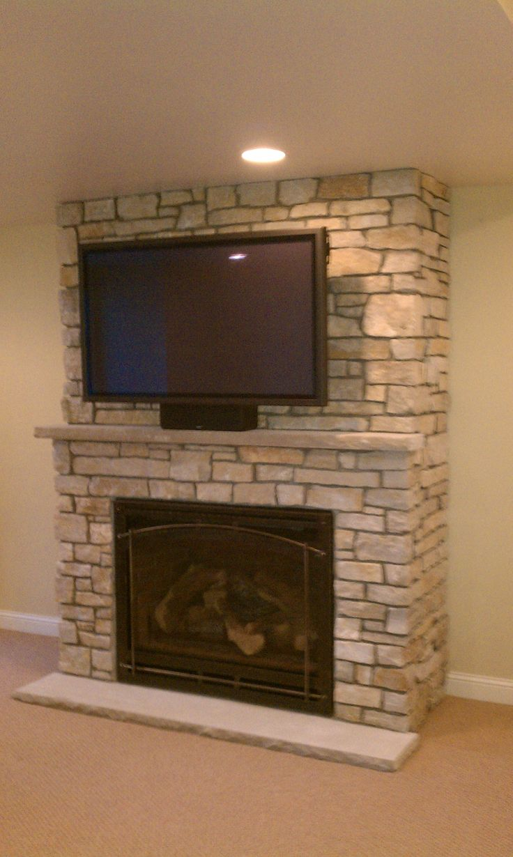 Curved Tv Above Fireplace