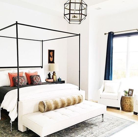Slim modern canopy bed in black and white bedroom design