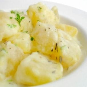 Pommes de terre à la crème fraîche et aux herbes