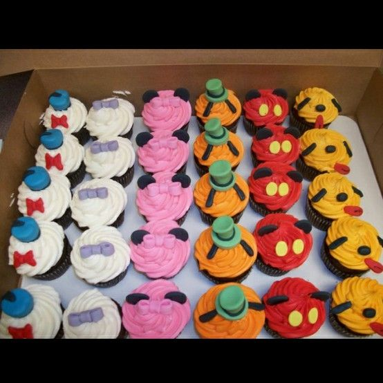 Disney cupcakes by desiree @Nora Griffin Griffin Griffin Griffin- the ears actually look pretty easy for Goofy and Pluto a lot smaller than I thought
