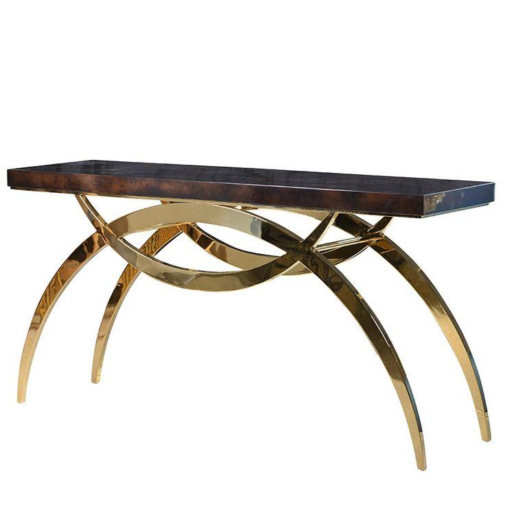 Art Deco inspirerat konsolbord i guld metall med elegant polerad skiva i brunsvart gjutglas. Det senaste inom internationell inredning.