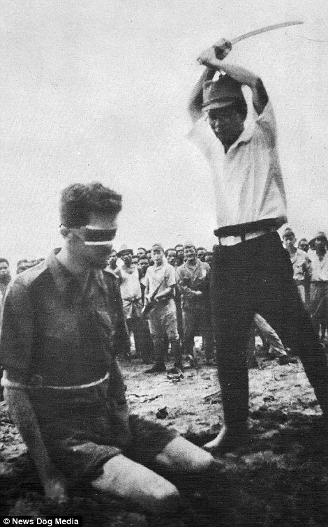 Australian POW Sergeant Leonard Siffleet, who was captured in New Guinea and photographed second before his savage beheading in 1942