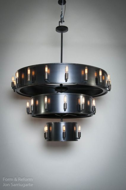 These custom metal light fixtures were designed by jon sarriugarte and built at form reform in oakland ca