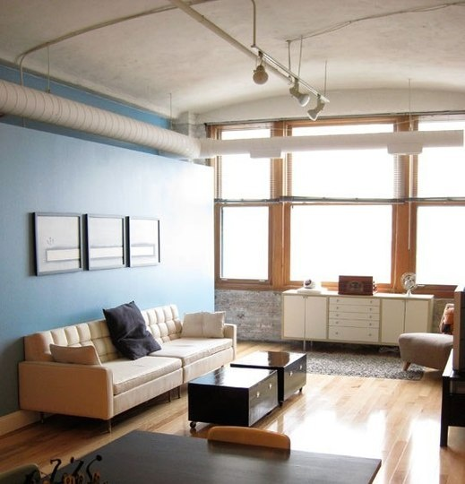 blue accent wall works with wood trim