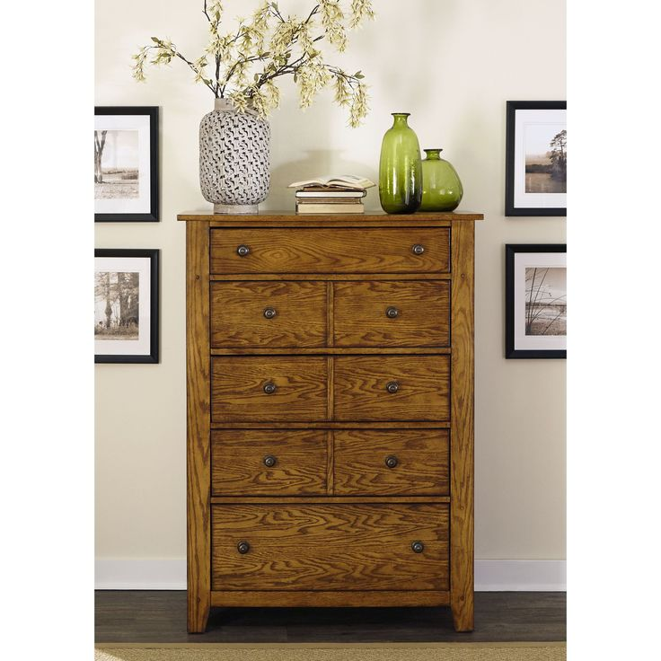 Grandpas Cabin 5-drawer chest offers a distinctive rustic, cozy cottage style. Craftsman design with a warm aged oak finish over ash and oak veneers gives this beautiful furniture a casual and inviting look.