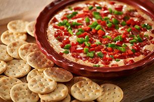 """My family devoured this!  Definitely making for my next get together!  One 8 oz. tub cream cheese spread & 1/2 cup pizza sauce mixed well and spread in bottom of 9"""" pie pan.  Layer with 3/4 cup mozzarella cheese  3/4 cup mini pepperoni, 1/2 cup chopped peppers (I used red & green), 1/4 cup chopped onions or whatever veggies you want.  Heat through (about 20 min or when cheese melts) @350 degrees.  Serve with Italian flavor flatbread crackers (I used Townhouse flatbread crisps).  So good!!!"""