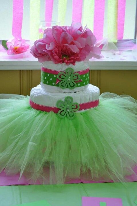 Cute pink and green diaper cake with flowers and tulle - so cute for a baby shower!