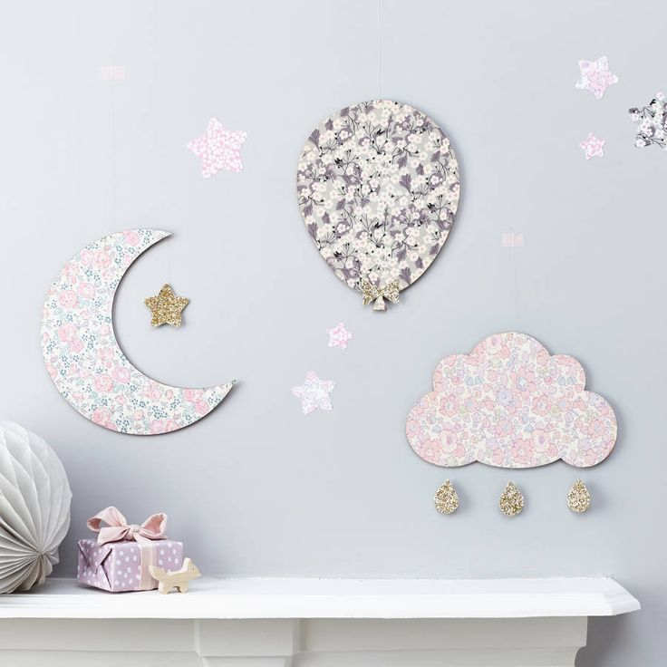 Mix and match your favourite wall hangings to create a unique feature wall. Each wooden shape is covered in Liberty of London fabric on both sides. The moon has a pale gold glittering star nestled in its crescent, whilst the cloud's glitter drops add a magical touch, catching the light as they float down. Affiliate link for noths