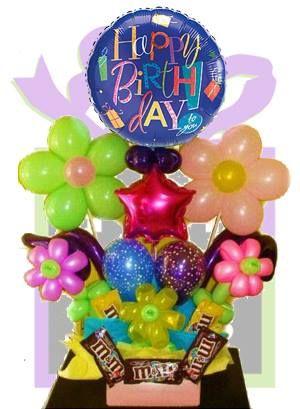 Arreglo con globos y dulces