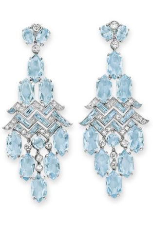 *A PAIR OF ART DECO AQUAMARINE AND DIAMOND EAR PENDANTS, BY CARTIER  Each of chandelier design, suspending a fringe of hexagonal-cut aquamarines, from the rectangular-cut aquamarine and single-cut diamond openwork plaque, to the old European-cut diamond and oval-cut aquamarine surmount, mounted in platinum, circa 1930.