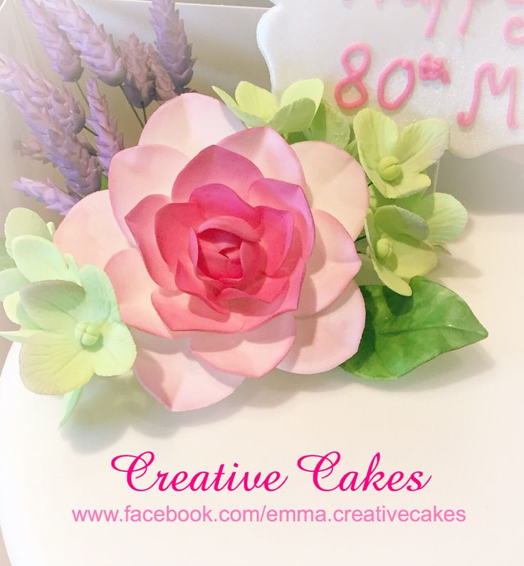 Pretty flower cake topper using pink flower, purple lavender and green hydrangea's - hand crafted by Creative Cakes