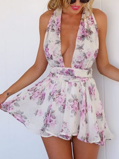 Embrace free-spirited vibes in this romper. The allover watercolor floral print and V-neckline practically make it a work of art.