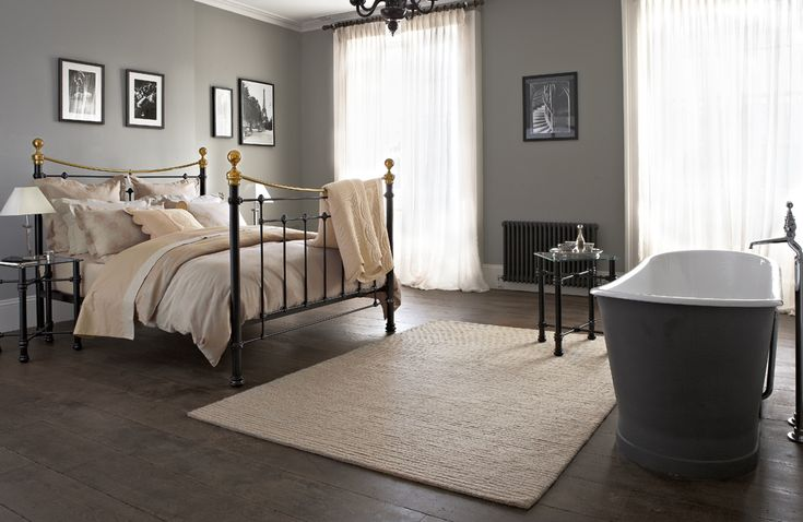 The ultimate luxury, a classic metal bed and a roll top bath in your bedroom.