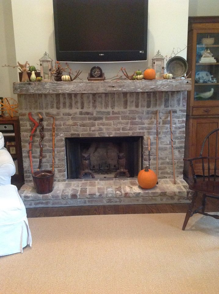 Susan Barrow shows off her mantel shelf made from a salvaged wood beam from Southern Accents Architectural Antiques