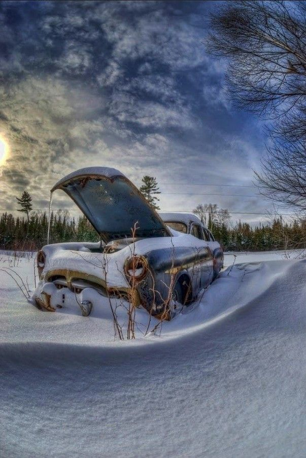 This old car was once someone's dream! Now just memories in the snow.