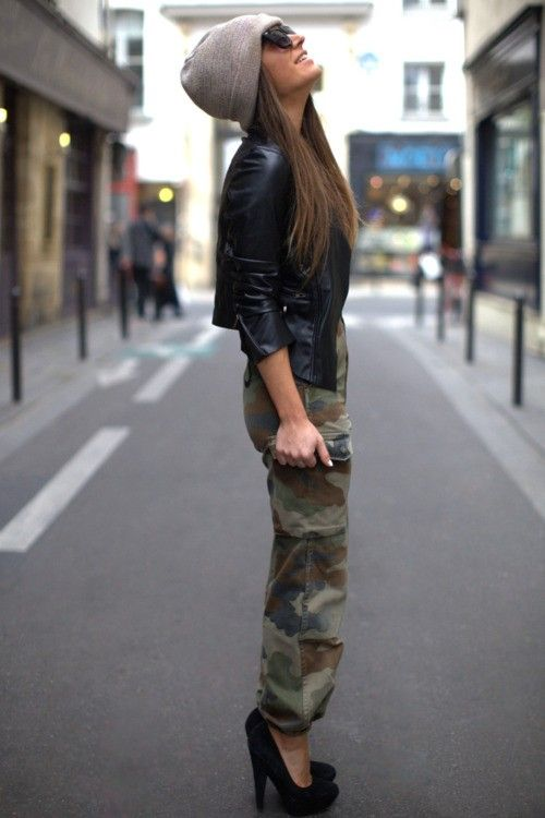Leather jacket, camouflage pants, high heels.  the obligatory beenie very urban...HOW ABOUY WEDGES INSTEAD OF HEELS!