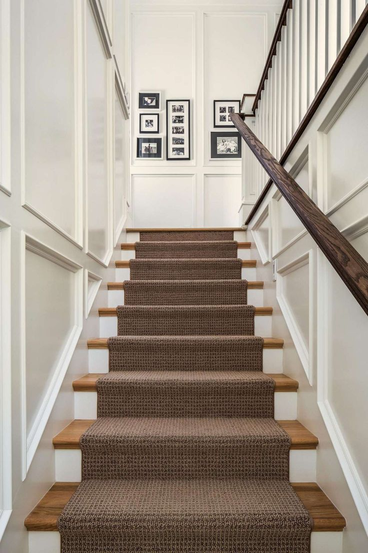 textured brown runner on wood and white stairs