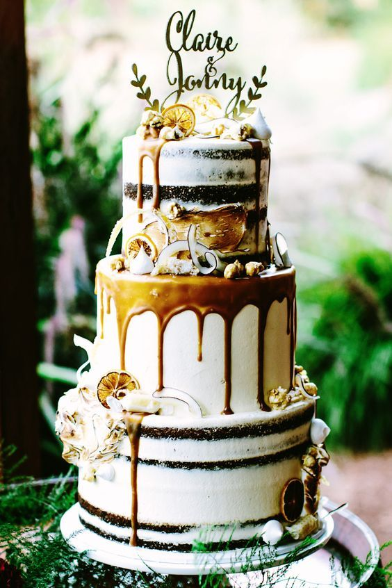 Gold boho wedding cake with caramel drip, candied lemon and shaved coconut | Bianca Kate Photography | See more: http://theweddingplaybook.com/bright-bohemian-winery-wedding/