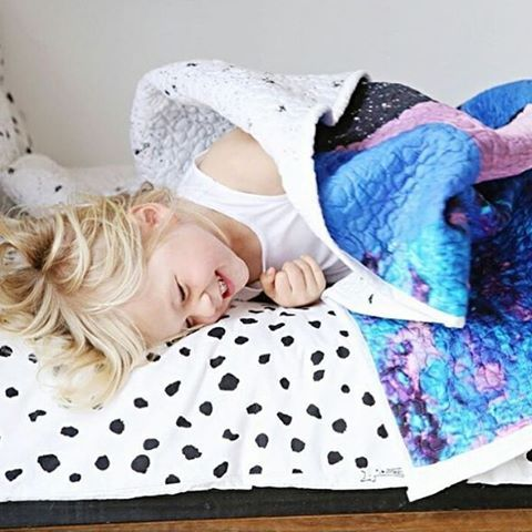 What a cutie! Jovi (@jovi_c_) snuggled up under one of the most unique designs I've done…Space / moon fabric design for The Midnight Gang by Australian textile designer Ellie Whittaker