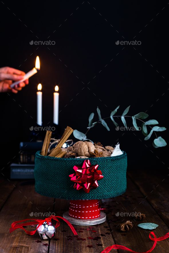 Festive Tin Filled with Nuts on Rustic Table against Candlelit Background - Stock Photo - Images Download here : https://photodune.net/item/festive-tin-filled-with-nuts-on-rustic-table-against-candlelit-background/18917244?s_rank=2&ref=Al-fatih