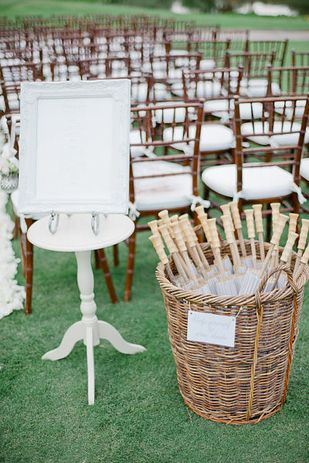 Provide guests with their own parasols. | 32 Totally Ingenious Ideas For An Outdoor Wedding