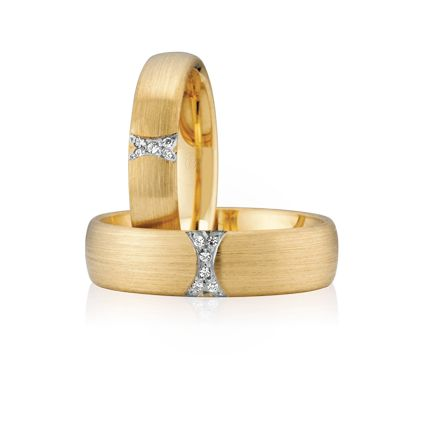 Australian Made Wedding Rings- Like you and your partner, these rings are made for each other. And, while they are designed to match, the subtle nuances and the eternal differences can be seen. Elegant and refined, the ladies ring displays fewer diamonds, while, with more diamonds, the men's ring is bolder and wider. The similarity evokes united minds and love while the diamonds evoke two distinct souls from which every relationship grows.