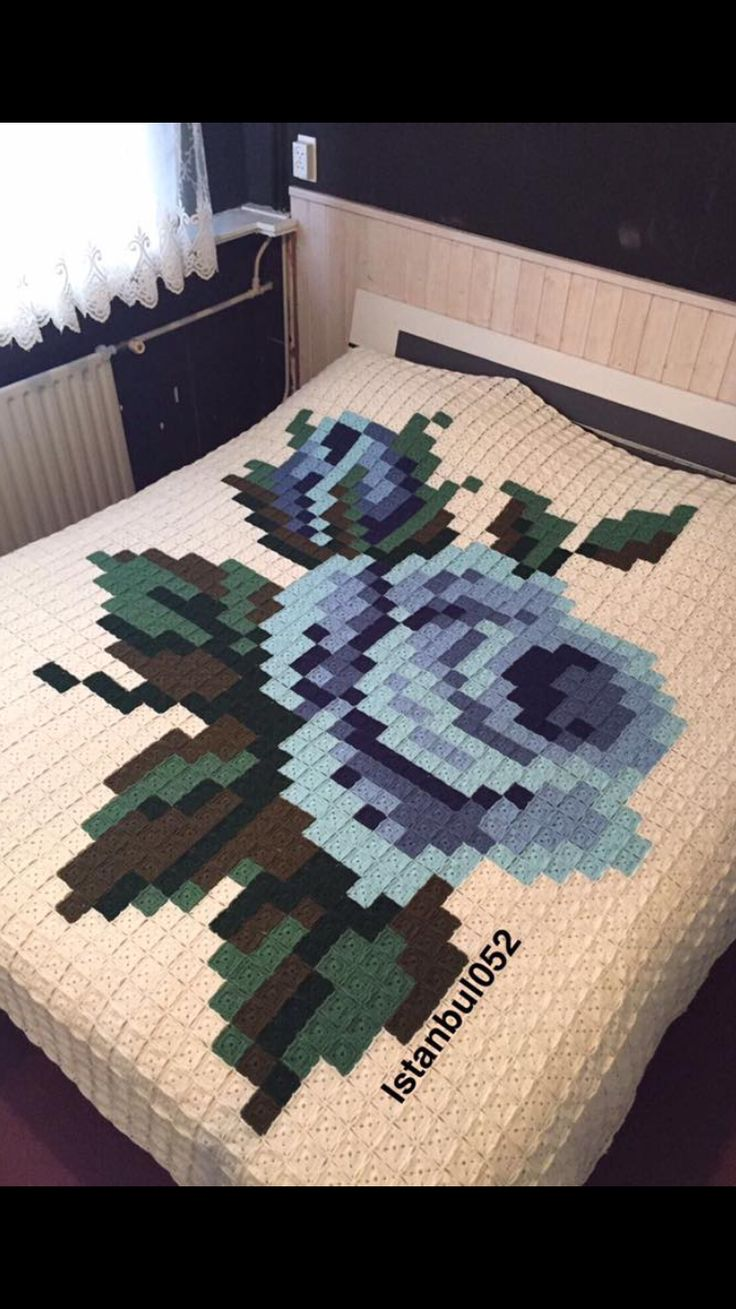 Amazing pixelated granny square rose afghan
