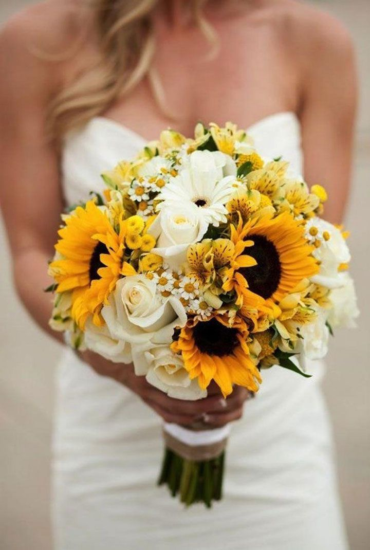 Love this yellow and white bouquet of sunflowers, roses, gerber daisies, chamomile and alstroemeria ~ we ❤ this! moncheribridals.com
