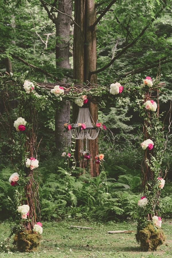 Woodland wonderland flower arch in the middle of a forest @myweddingdotcom