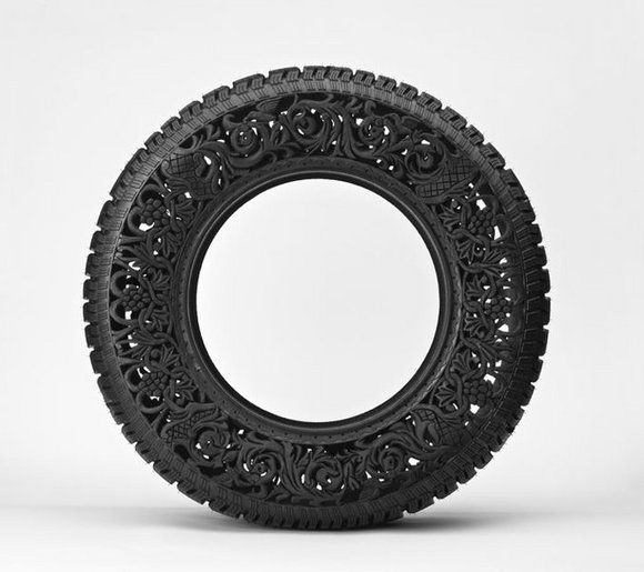 """Belgian artist Wim Delvoye brings new life to used tires in his series, """"Pneu"""". Delvoye hand-carved intricate patterns and designs into the rubber to """"transform things that seem useful in everyday life into sculptural pieces that carry a different value from their original intended purpose"""". Delvoye's art makes it clear that the value of something is not only found in it's purpose and that beauty can be found unexpectedly."""