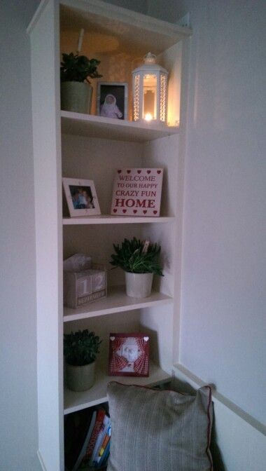 This custom made bookcase forms the gable of a storage bench...super stylish way of creating practical storage solutions!